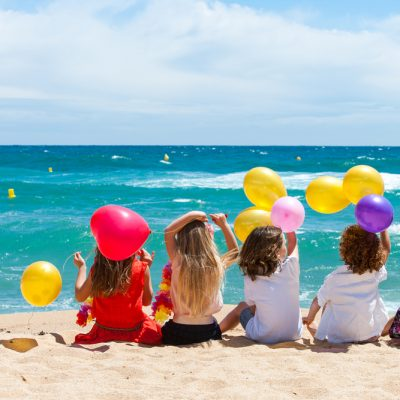 Children Sitting On Beach