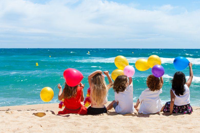 Children Sitting On Beach