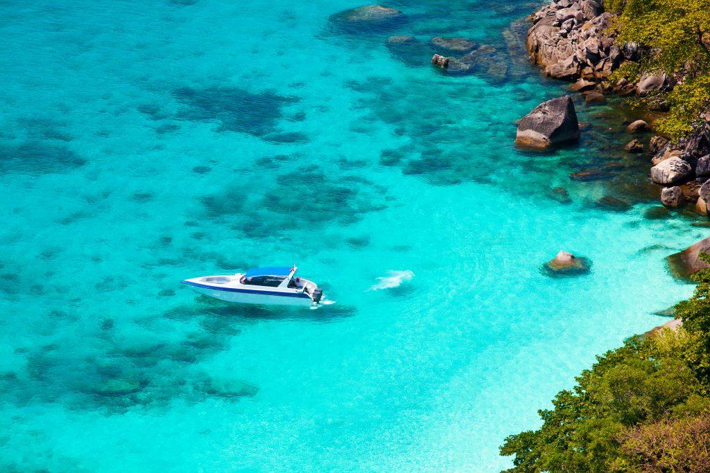 Charter a boat in a beautiful ocean.