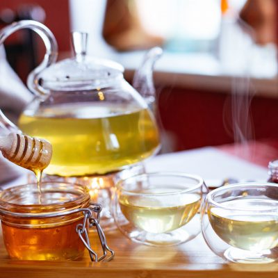 teapot-and-teacups-with-tea-and-honey-on-tray