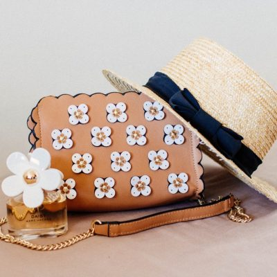 brown-sun-hat-on-brown-and-white-floral-sling-bag
