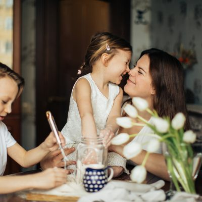 photo-of-woman-playing-with-her-children