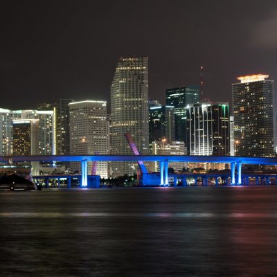 Photo of Miami skyline at night.