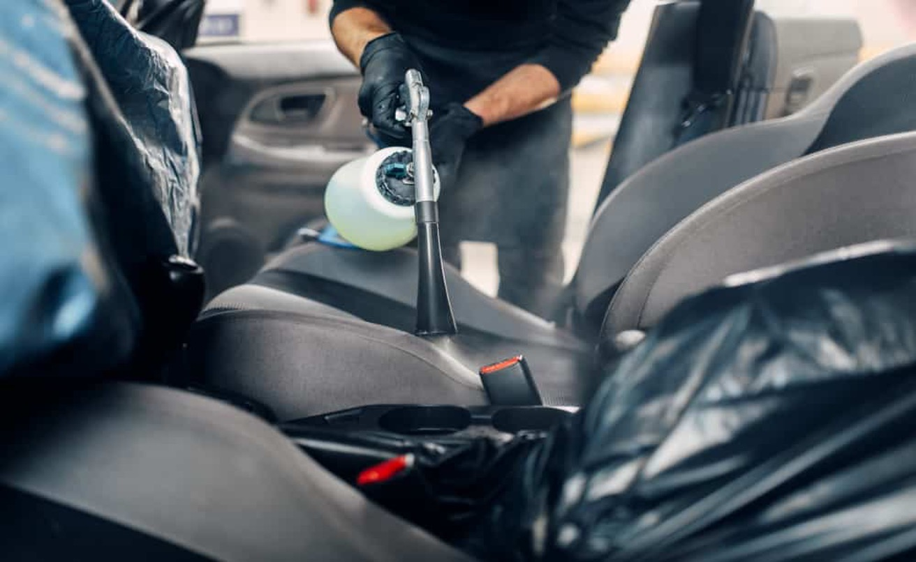 Disinfecting the inside of a car.
