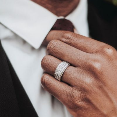 mens-wedding-band-styles-man-adjusting-tie-mobile